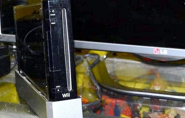 पटकथा शीर्षक वायर्ड कनेक्शन का उपयोग इंटरनेट के साथ अपने Wii कनेक्ट करने के लिए चरण 3